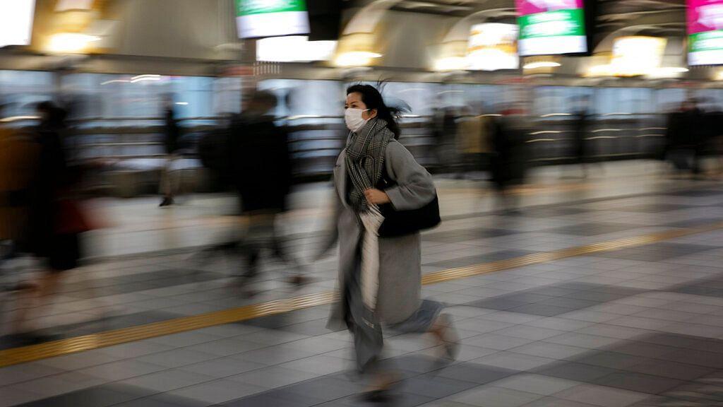 A woman hurries to a platform at the Shinagawa Station in Tokyo, Monday, 2 March, 2020.