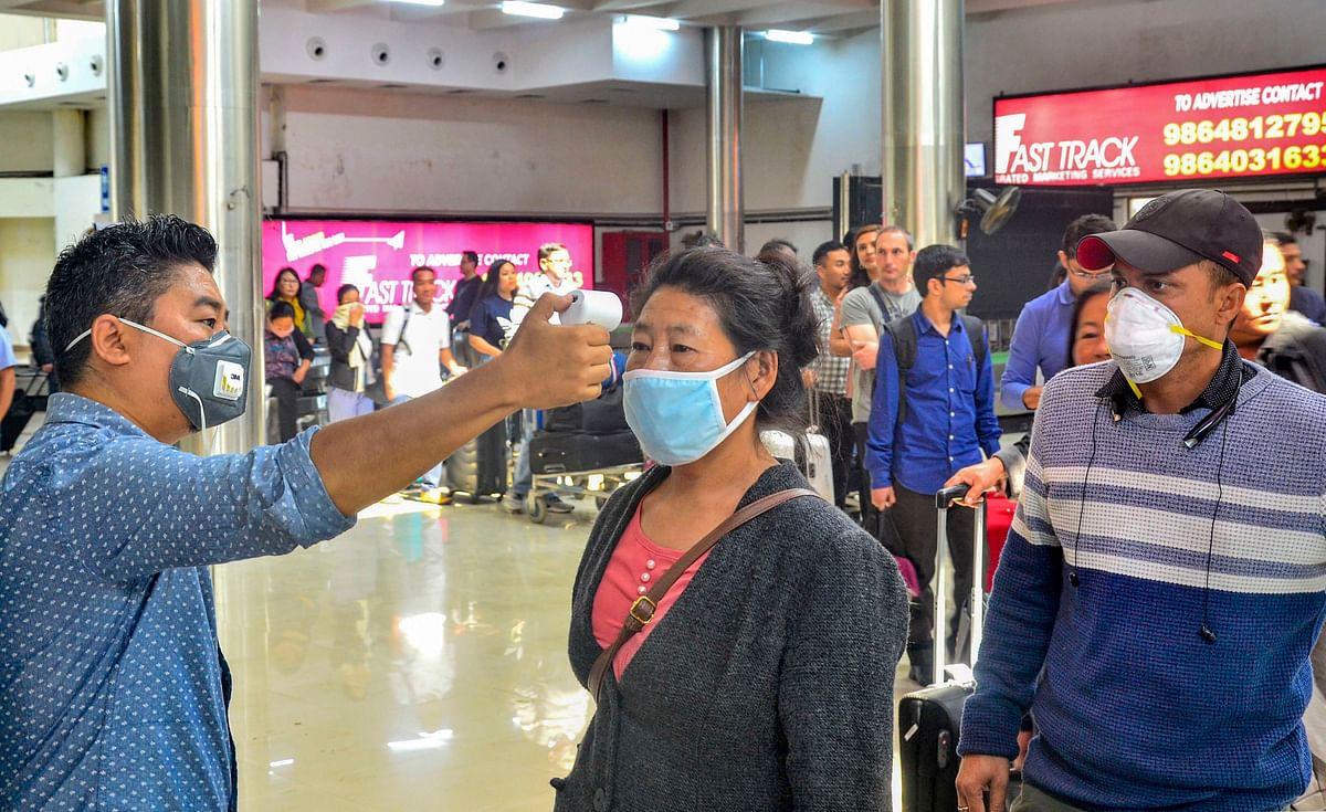 Passengers undergo a thermal screening test in the wake of novel coronavirus scare at Dimapur airport in Nagaland, Sunday.