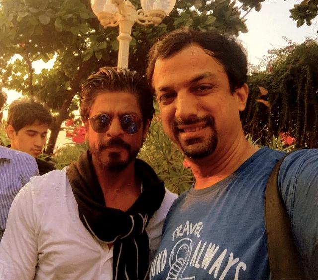 Photographer Manav Manglani with actor Shah Rukh Khan.