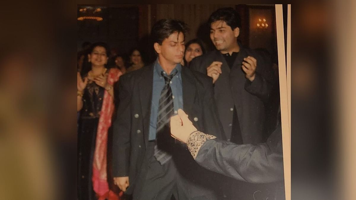 Karan Johar with Shah Rukh Khan at Sanjay Kapoor's sangeet in 1998.