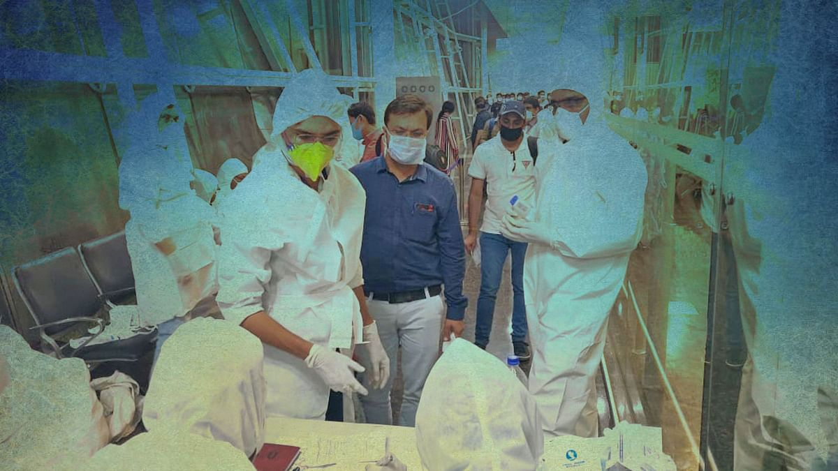 File image: Health officials screen passengers arriving from Dubai before being sent to hospital in the wake of coronavirus pandemic, in Indore, late Friday night, 20 March, 2020.