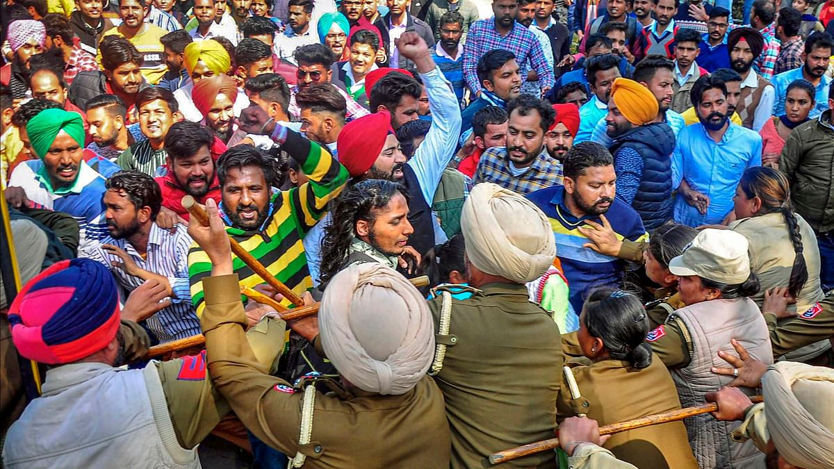 Police lathicharging protesters in Patiala during a march.