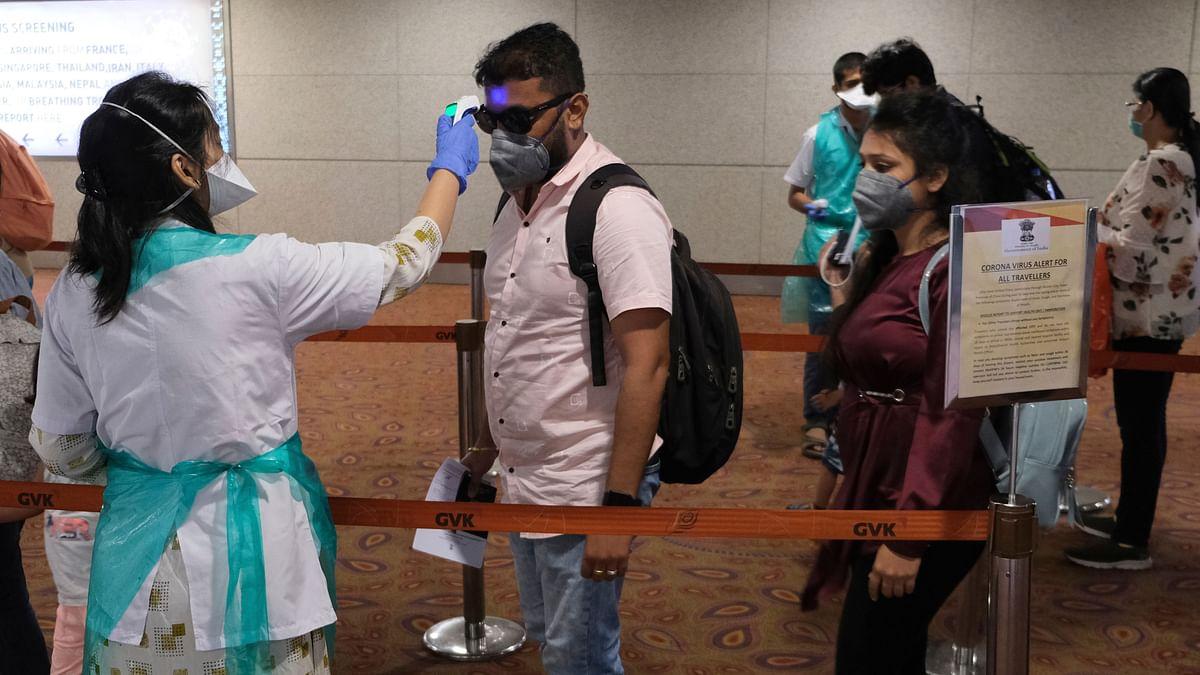 Passengers undergo temperature check as a precaution against a new coronavirus at Chhatrapati Shivaji International Airport in Mumbai.