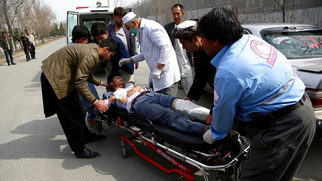 An injured man is carried into an ambulance after an attack in Kabul, Afghanistan, on Friday, 6 March, 2020.