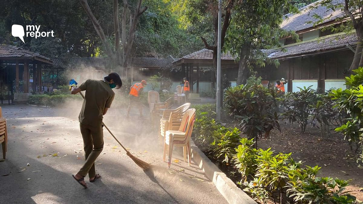 MCGM staff cleaning Kasturba Hospital premise where COVID-19 tests are being conducted in Mumbai.