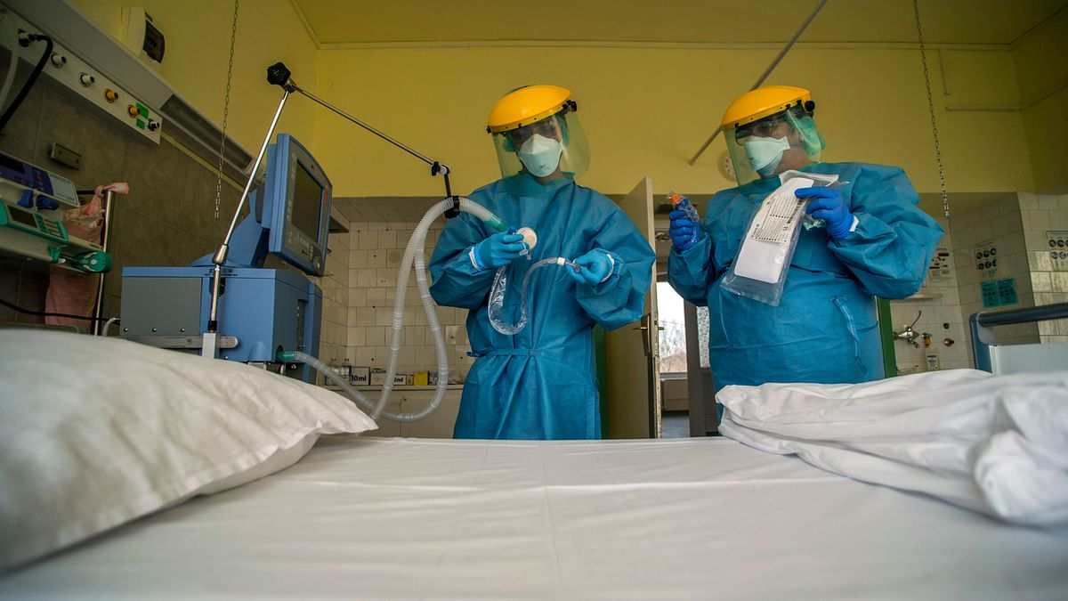 Medical staff members check a ventilator in protective suits at the care unit of the new COVID-19 infected patients in Budapest, Hungary.