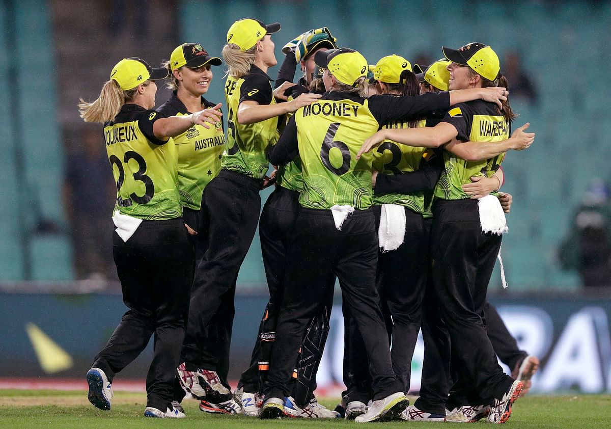 Australian teammates celebrate after winning their Women's T20 World Cup cricket semifinal match against South Africa in Sydney, Thursday, March 5, 2020.