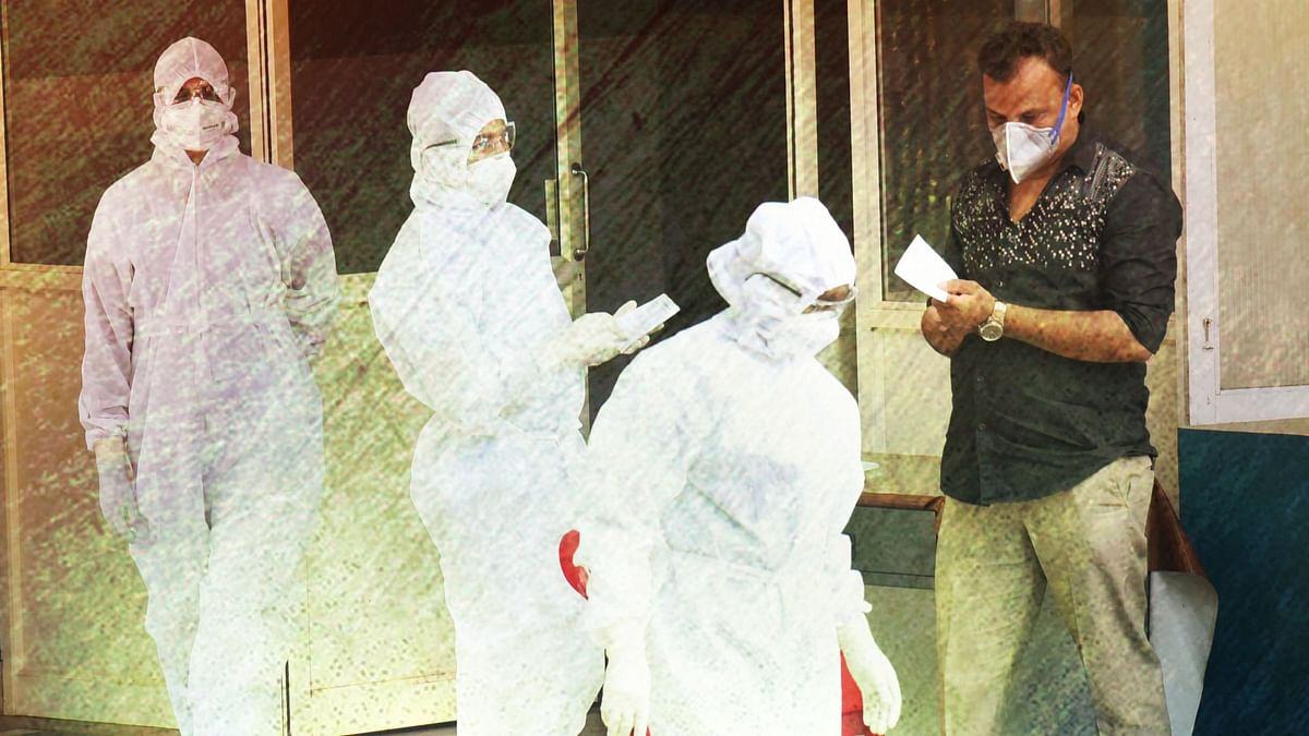 Medical staff members wear masks and protective suits to mitigate the spread of coronavirus, outside the special isolation ward of District Hospital Aluva in Kochi, Thursday, 12 March, 2020.
