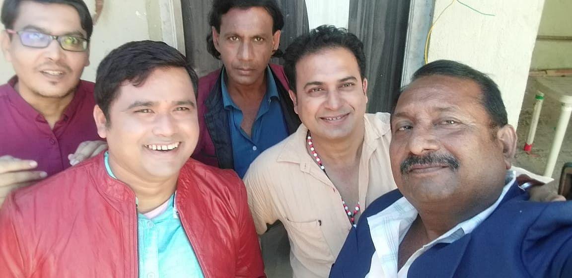 Ramesh Mishra (in beige) at a shoot in Mumbai.
