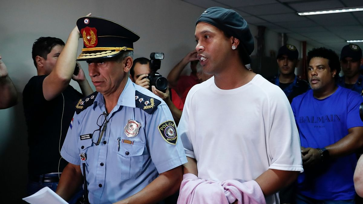 Ronaldinho and his brother Roberto were arrested for allegedly entering Paraguay with fake passports and travel documents.