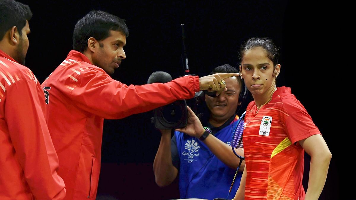 File picture of Pulella Gopichand and Saina Nehwal during the Gold Coast Commonwealth Games.