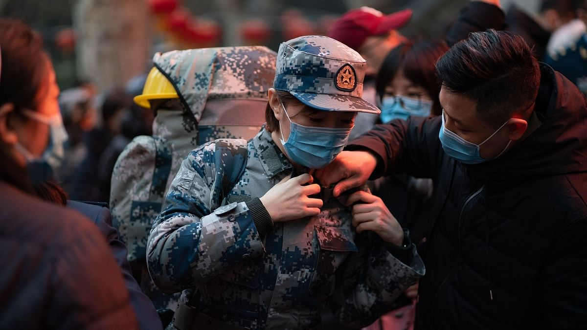 China Begins Withdrawal of Medical Staff From Virus-Hit Wuhan