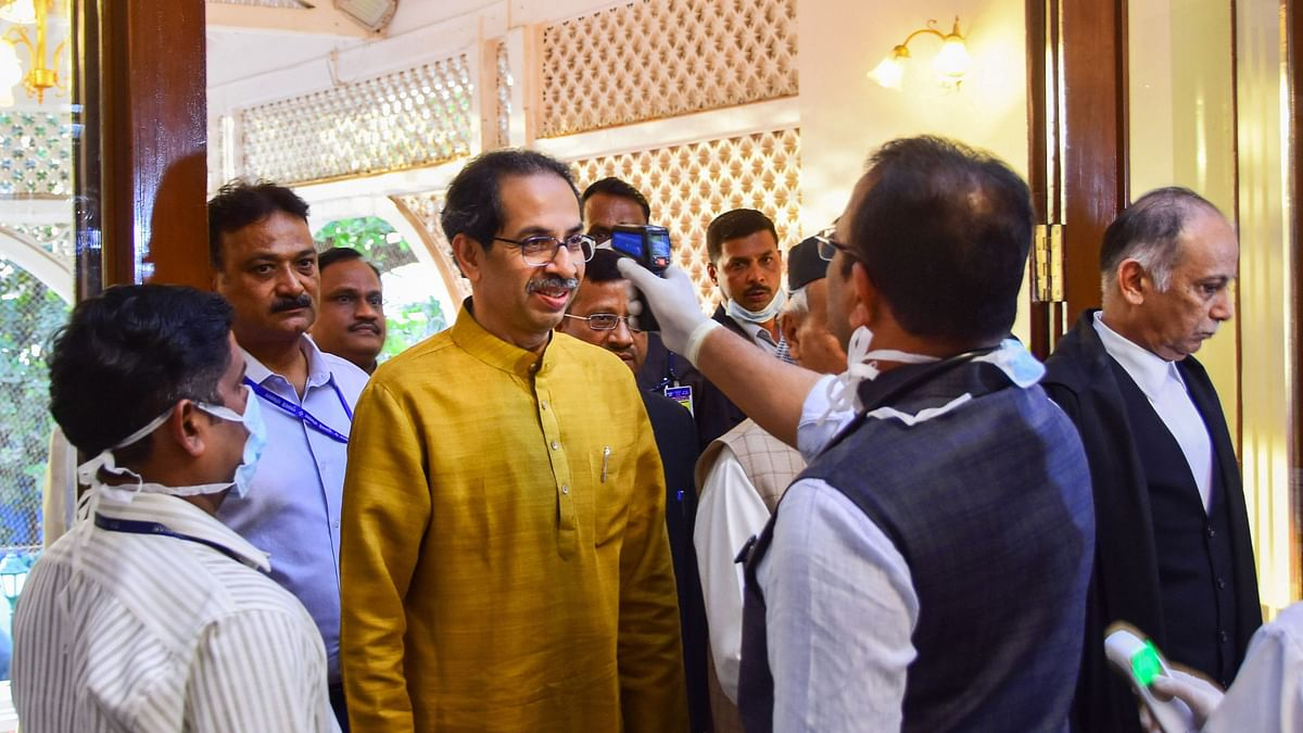 File Image: An official uses a thermal screening device on Maharashtra Chief Minister Uddhav Thackeray, in wake of deadly coronavirus outbreak.