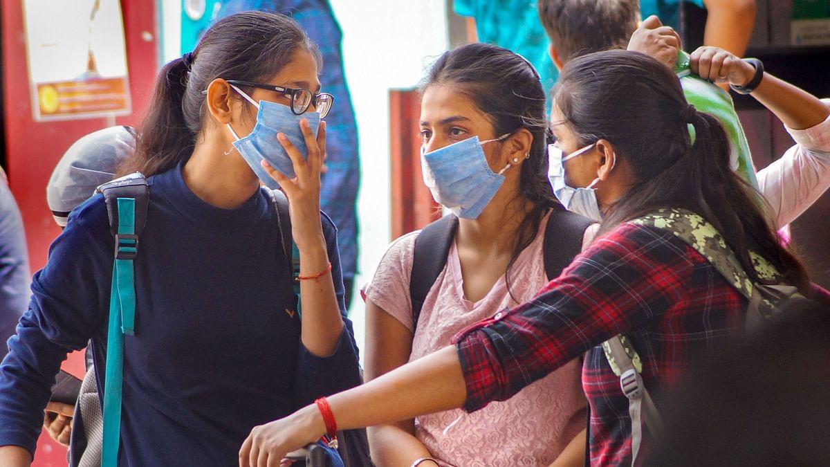 File Image of Passengers wear masks as a preventive measure against novel coronavirus (COVID-19) pandemic, at Bhubaneswar railway station.