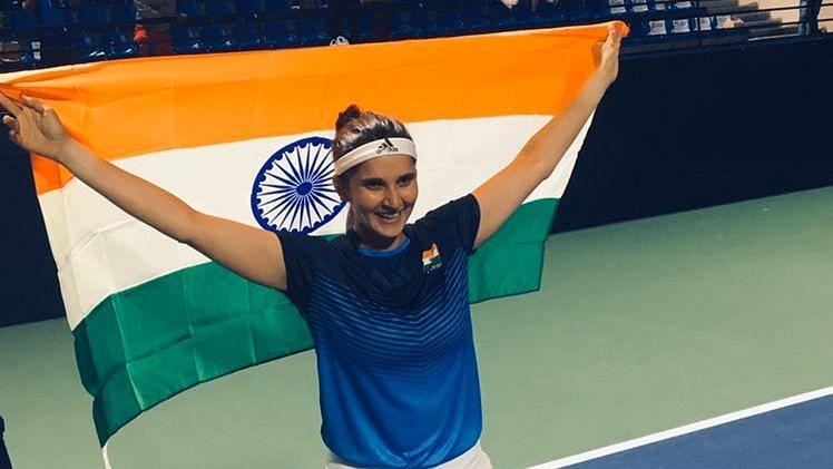 Sania Mirza celebrates with the Indian flag.