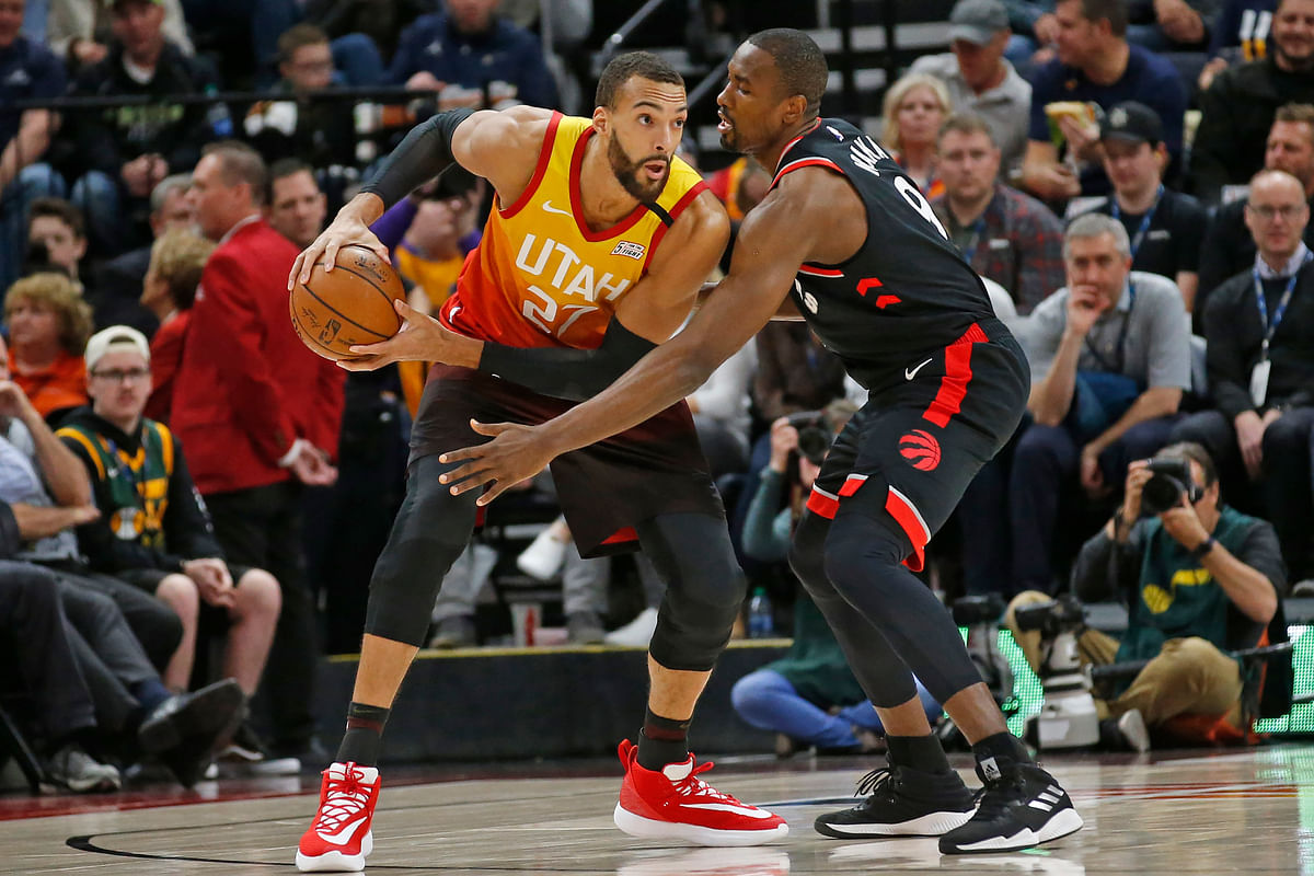 Toronto Raptors center Serge Ibaka (9) guards against Utah Jazz center Rudy Gobert (27) in the first half during an NBA basketball game Monday, March 9, 2020.