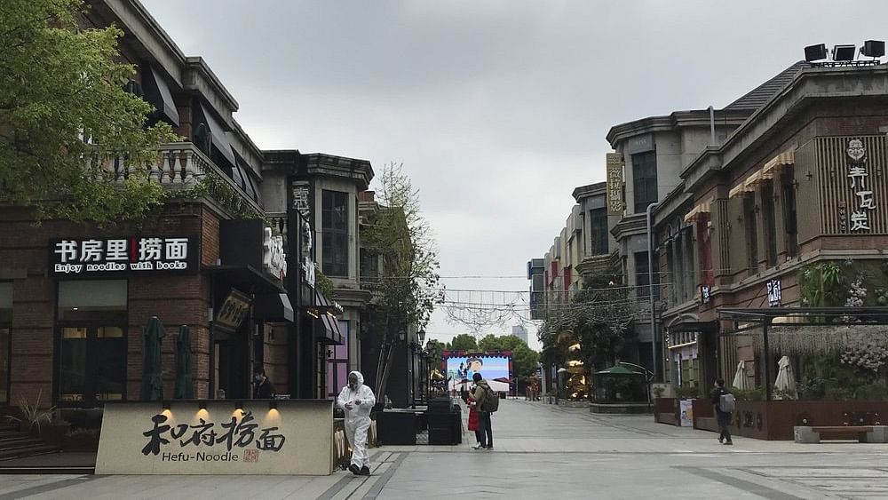 Shopkeepers in the city at the center of China's virus outbreak were reopening on Monday but customers were scarce after authorities lifted more of the anti-virus controls that kept tens of millions of people at home for two months.