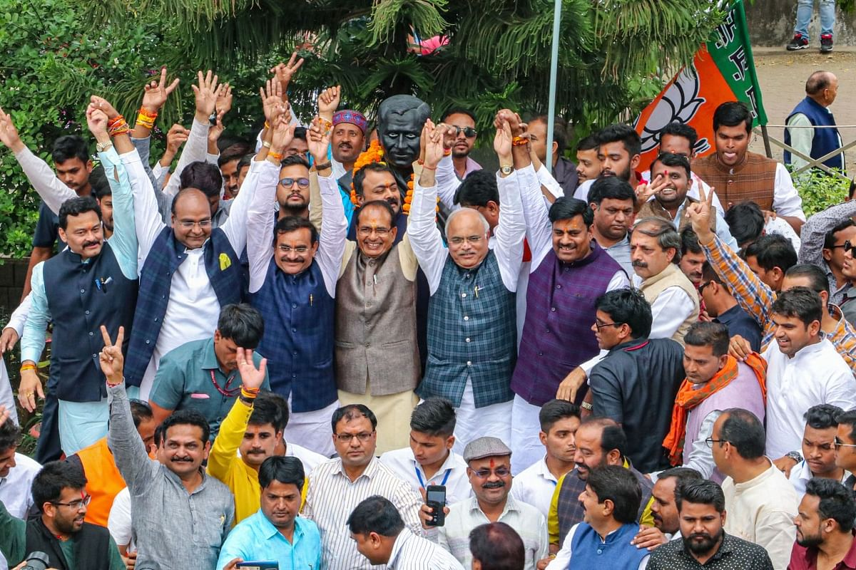 Bharatiya Janata Party (BJP) leader Shivraj Singh Chouhan, center, celebrates with party colleagues after Congress party leader Kamal Nath resigned as Chief Minister of India's central state of Madhya Pradesh in Bhopal, India, Friday, 20 March 2020