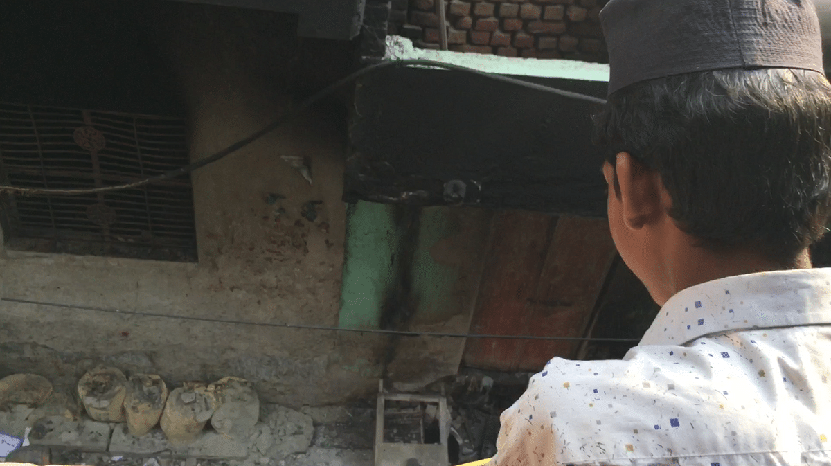 Safi looks down at the destruction in Gali No 4 of Khajoori Khas from atop his madrasa which was set ablaze by a mob.