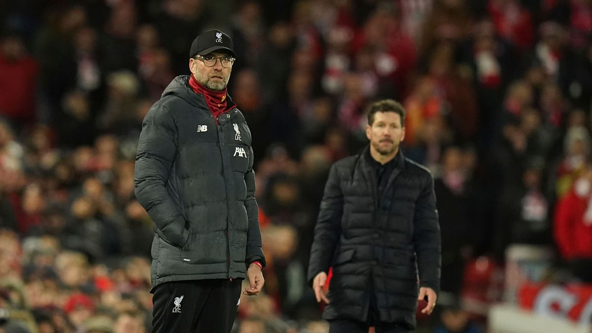 Liverpool's Jurgen Klopp and Atletico's Diego Simeone at the sidelines during their match at Anfield stadium in Liverpool on Wednesday.