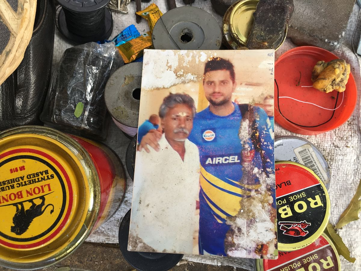 Baskaran carries a picture of him with Suresh Raina always.