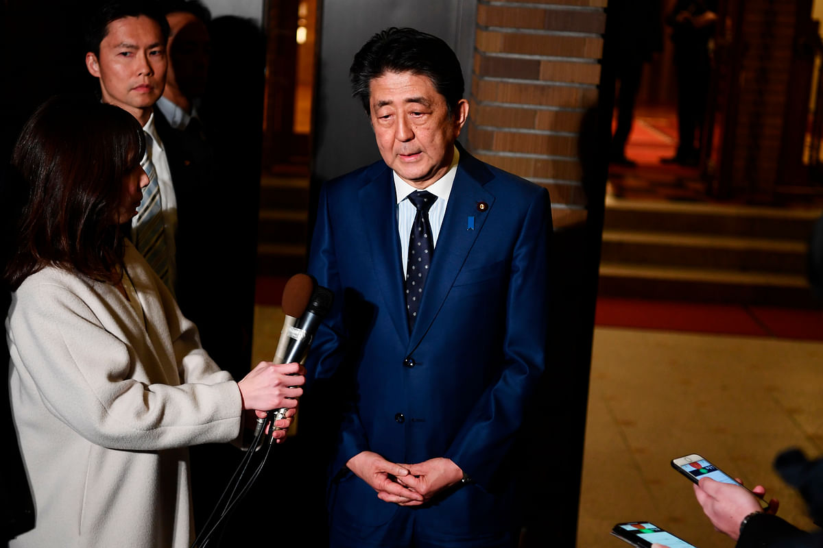 Japan's Prime Minister Shinzo Abe talks to journalists after making decision to postpone the Tokyo Olympics with the IOC President Thomas Bach, in Tokyo, Tuesday, March 24, 2020.