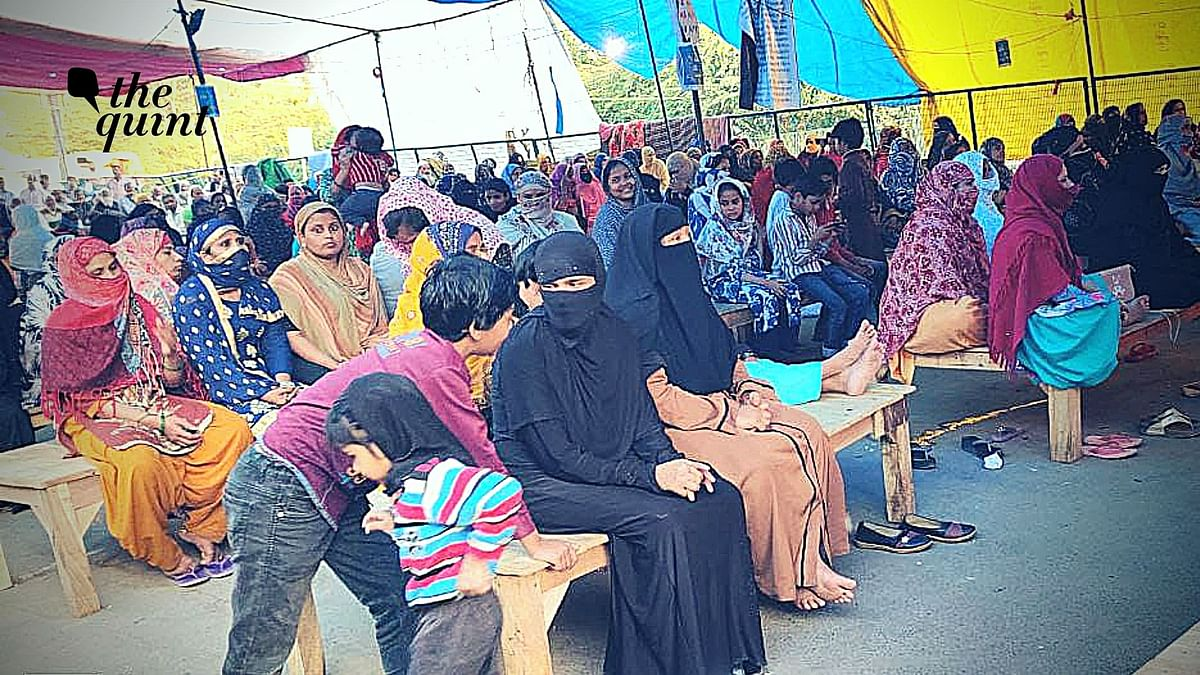 Shaheen Bagh protesters sitting on wooden beds during Coronavirus pandemic threat.