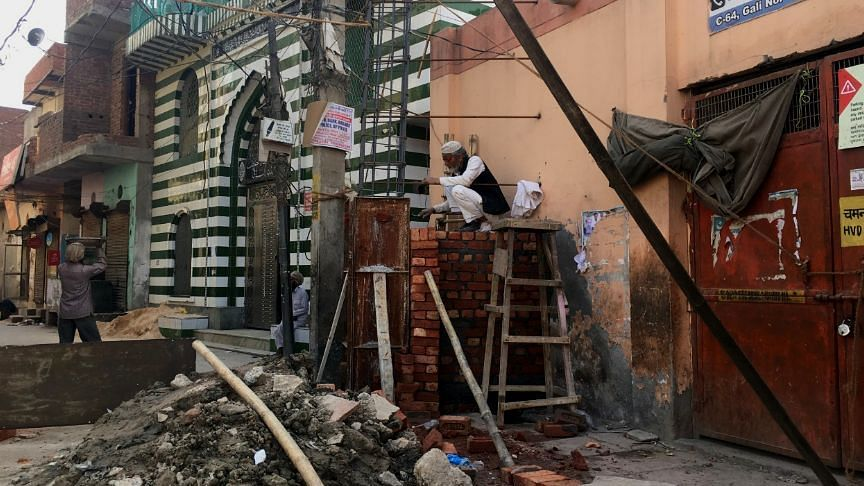 Shiv Vihar residents building permanent gates for safety in the aftermath of the riots.