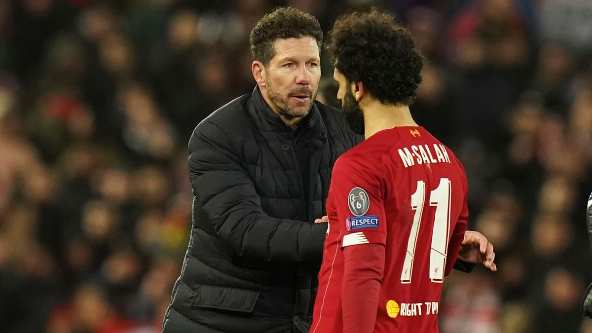 Atletico Madrid coach Diego Simeone with Liverpool's Mo Salah after their Champions League match in Liverpool on Wednesday.
