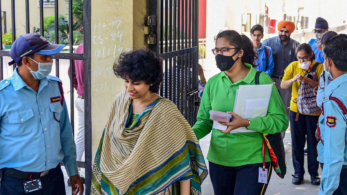Teachers and students of Shriram Millennium School leave the campus as the school closes for two days.