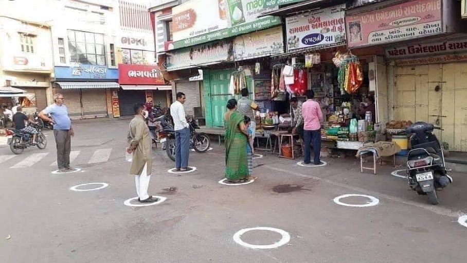 A grocery store in Puducherry drew circles on the road for people, to stand away from each other as they wait in a queue.