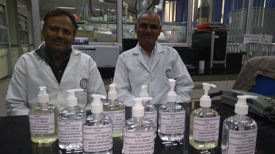 IIT Delhi director with the Chemistry professor who made their own hand sanitiser.