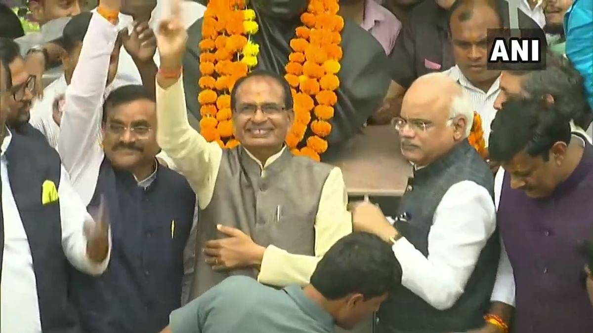 Shivraj Singh Chouhan with BJP members at party office in Bhopal.