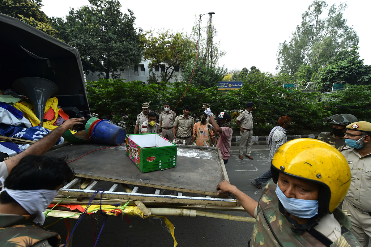 Items removed from Shaheen Bagh protest site being taken into a truck.