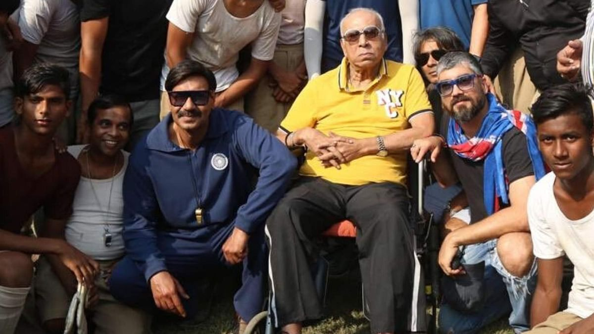 Ajay Devgn with late Indian footballer PK Banerjee.