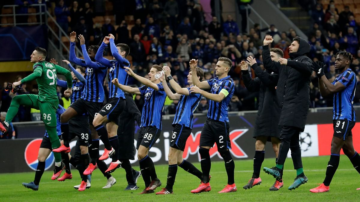 In this Wednesday, Feb. 19, 2020 file photo, Atalanta players celebrate at the end of the Champions League round of 16, first leg, soccer match between Atalanta and Valencia at the San Siro stadium in Milan, Italy.