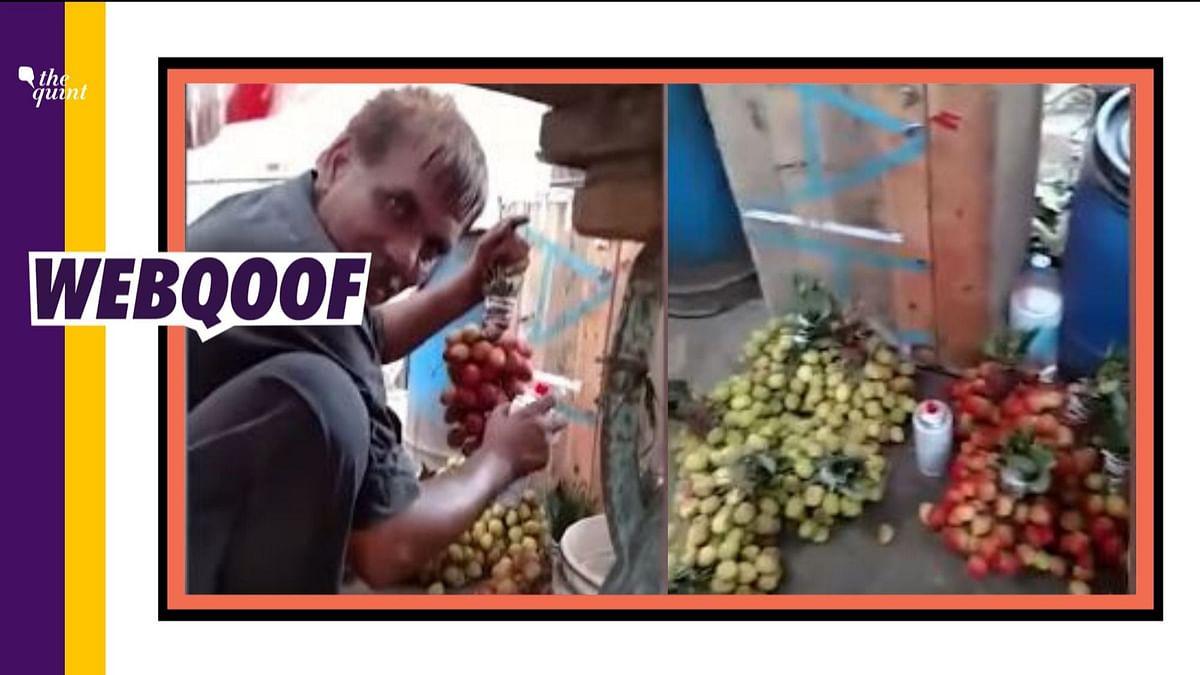Man spray painting fruits in Pakistan's Afzalpur.