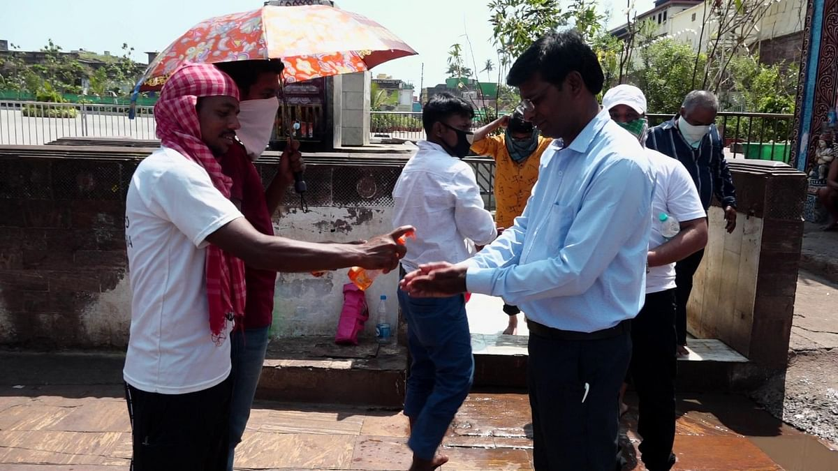 Devotees were asked to sanitise before entering the temple premises.