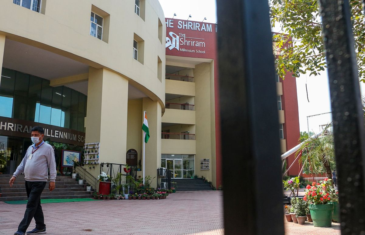 A staff member of Shriram Millennium School leaves the campus as the school closed for two days after a student's parent tested positive for novel Coronavirus.