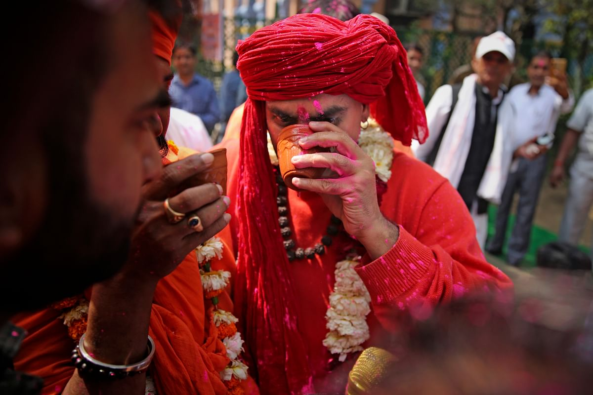 National president of Akhil Bhartiya Hindu Mahasabha Swami Chakrapani Maharaj drinks cow urine during an event organized by a Hindu religious group to promote consumption of cow urine as a cure for the new coronavirus in New Delhi, India, Saturday, 14 March 2020.