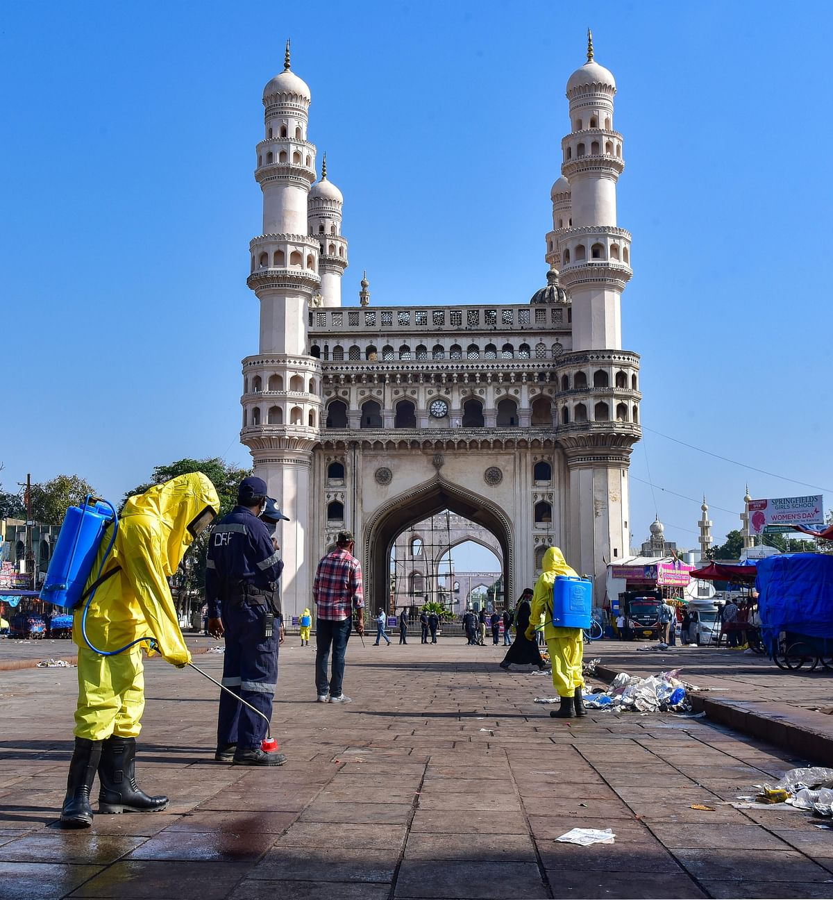 Hyderabad: Workers disinfect an area near the historic Charminar during Janata curfew.