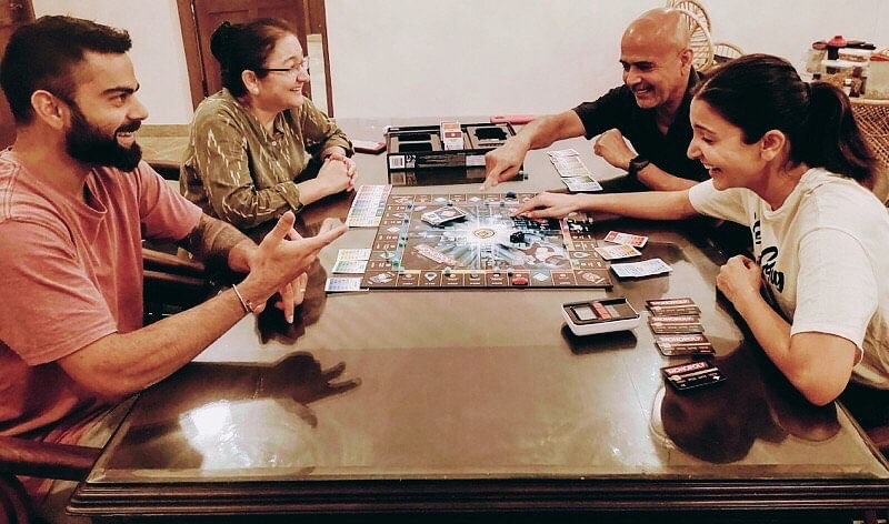 Anushka Sharma posted a picture of Virat and her playing monopoly with her parents a few days ago.
