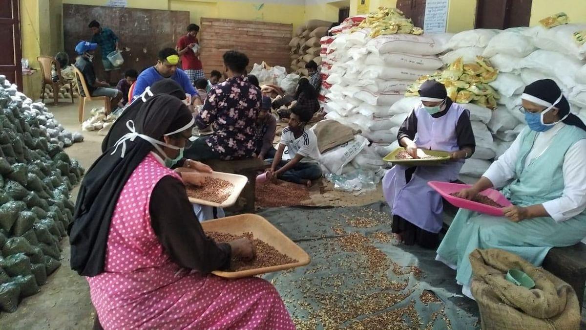 Nuns from Podimattam CMI Convent working on making food kits.