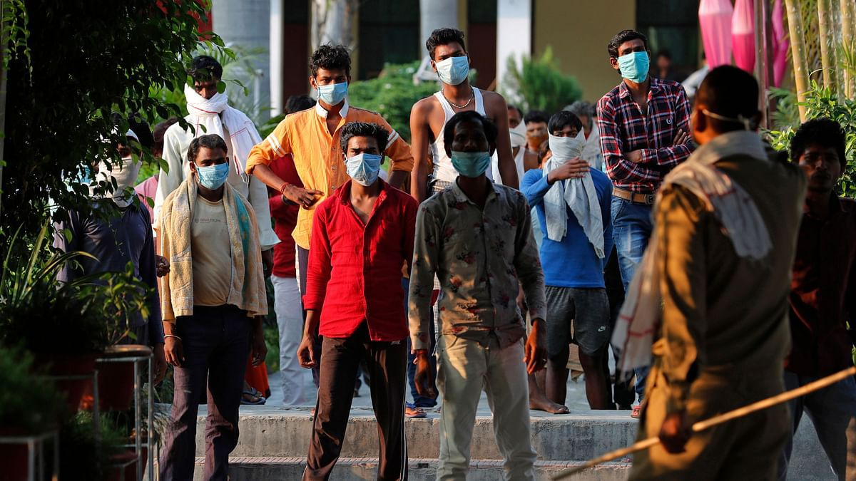 Indian laborers kept in quarantine after arriving from outside the state protest against poor treatment at the quarantine center in Prayagraj.