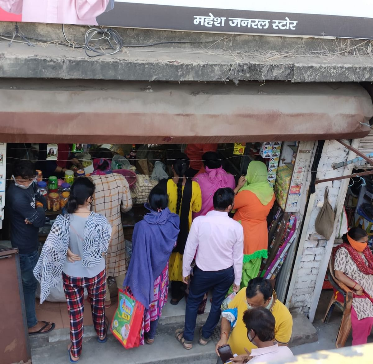 People queue outside a shop in Lucknow's Nishatganj area soon after news reports of hotspots being sealed.
