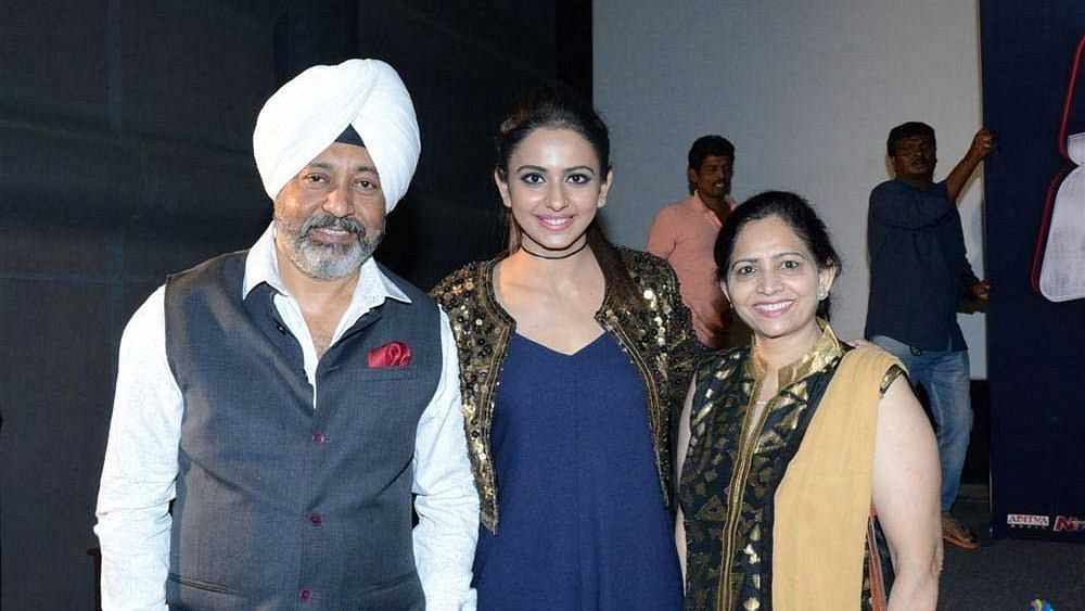 Rakul Preet (in the centre) with her parents.