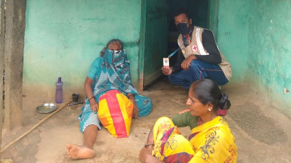 Umesha, with a family he supplied food and rations to.