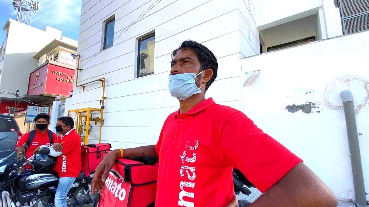 Raju Das, who works with Zomato, waiting at Sector 104, Noida.