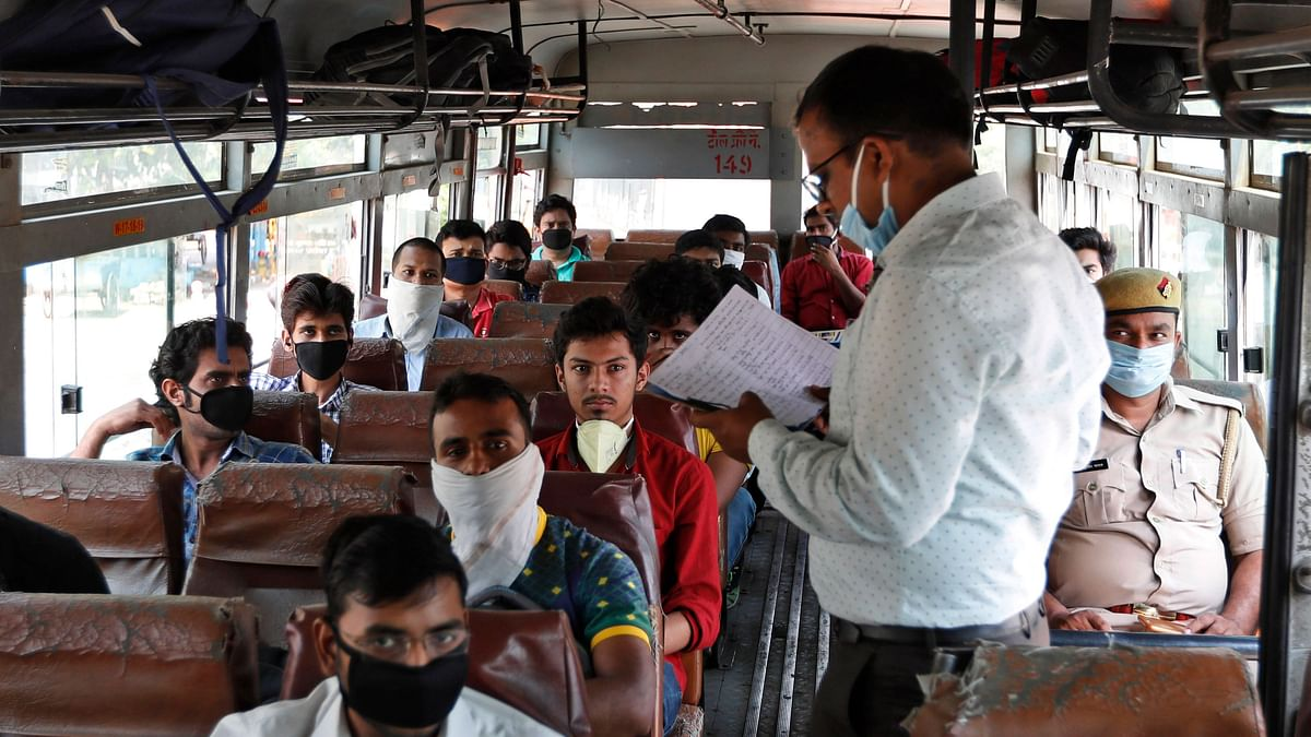 Students who had been stranded in the city for more than a month due to lockdown to prevent the spread of new coronavirus board specially scheduled buses to their respective hometowns in Prayagraj, Tuesday, 28 April 2020.