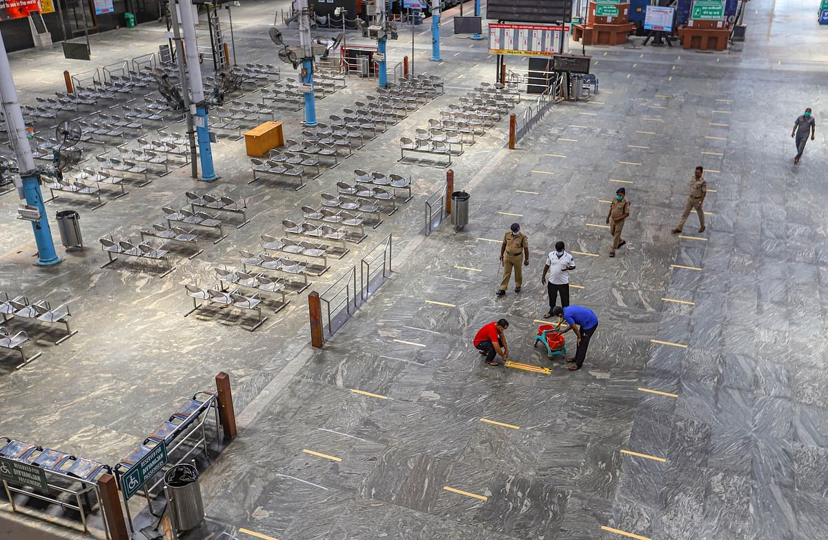 Chennai: Railway Protection Force  personnel draw social distancing mark on a floor at Dr MG Ramachandran Central Railway station during a government-imposed nationwide lockdown.
